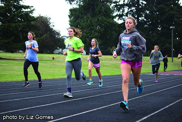 The women's cross country team practices for Saturday's regional championships.