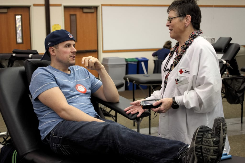 Community member, Kurt Knell, giving blood to American Red Cross.