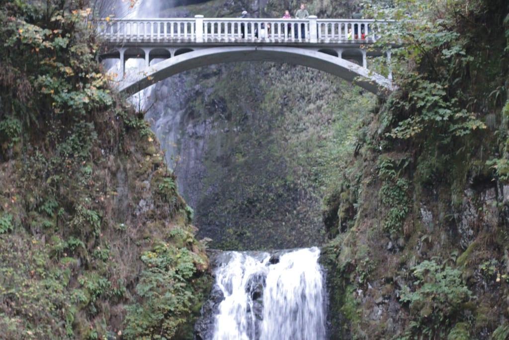 The rebuilt Benson Footbridge stands tall over Multnomah Falls.