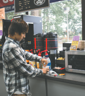 Clackamas student Jacob Gordon whips up a Cup Noodles, available in the bookstore for 89 cents.