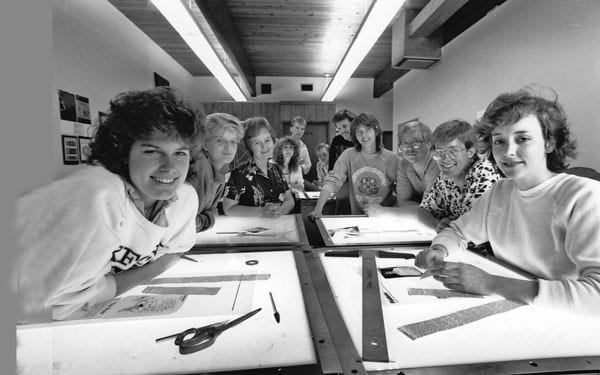 Previous Clackamas Print staff gather around the tables during production. Along with the college, The Clackamas Print, previously known as the Cougar Print, is celebrating 50 years of coverage at the college.