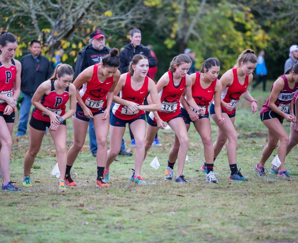 Clackamas woman's cross-country team waits for the race to start on Saturday, Oct. 15, at Willamette Mission State Park.